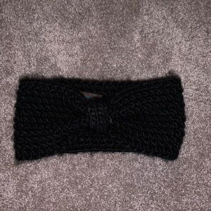 Black winter head band with a bow